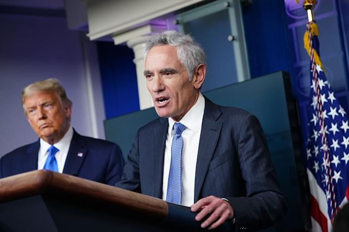 President Donald Trump (L) listens to White House coronavirus adviser Dr. Scott Atlas speak during a press conference in the Brady Briefing Room of the White House on September 23, 2020, in Washington, DC. (Mandel Ngan/AFP via Getty Images)