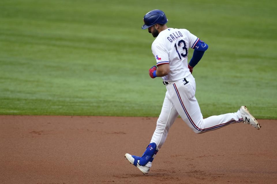 Texas Rangers' Joey Gallo rounds the bases after hitting a solo home run in the second inning of the team's baseball game against the San Francisco Giants in Arlington, Texas, Tuesday, June 8, 2021. (AP Photo/Tony Gutierrez)
