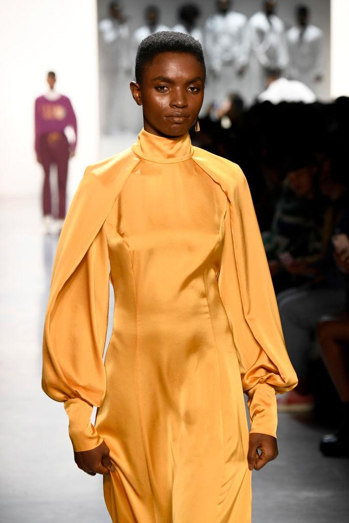 <p>Model wears a canary yellow gown at the Pyer Moss FW18 show. (Photo: Getty) </p>