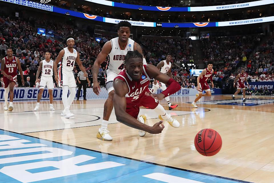 <p>Clayton Henry #5 of the New Mexico State Aggies dives for the ball during the first half against the Auburn Tigers in the first round of the 2019 NCAA Men's Basketball Tournament at Vivint Smart Home Arena on March 21, 2019 in Salt Lake City, Utah. (Photo by Tom Pennington/Getty Images) </p>