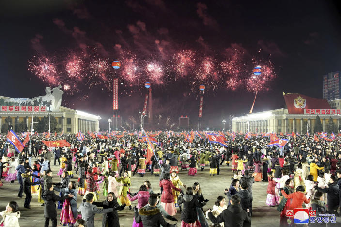 """In this photo provided by the North Korean government, people dance in the celebration for the ruling party congress, at Kim Il Sung Square in Pyongyang, North Korea Thursday, Jan. 14, 2021. Independent journalists were not given access to cover the event depicted in this image distributed by the North Korean government. The content of this image is as provided and cannot be independently verified. Korean language watermark on image as provided by source reads: """"KCNA"""" which is the abbreviation for Korean Central News Agency. (Korean Central News Agency/Korea News Service via AP)"""