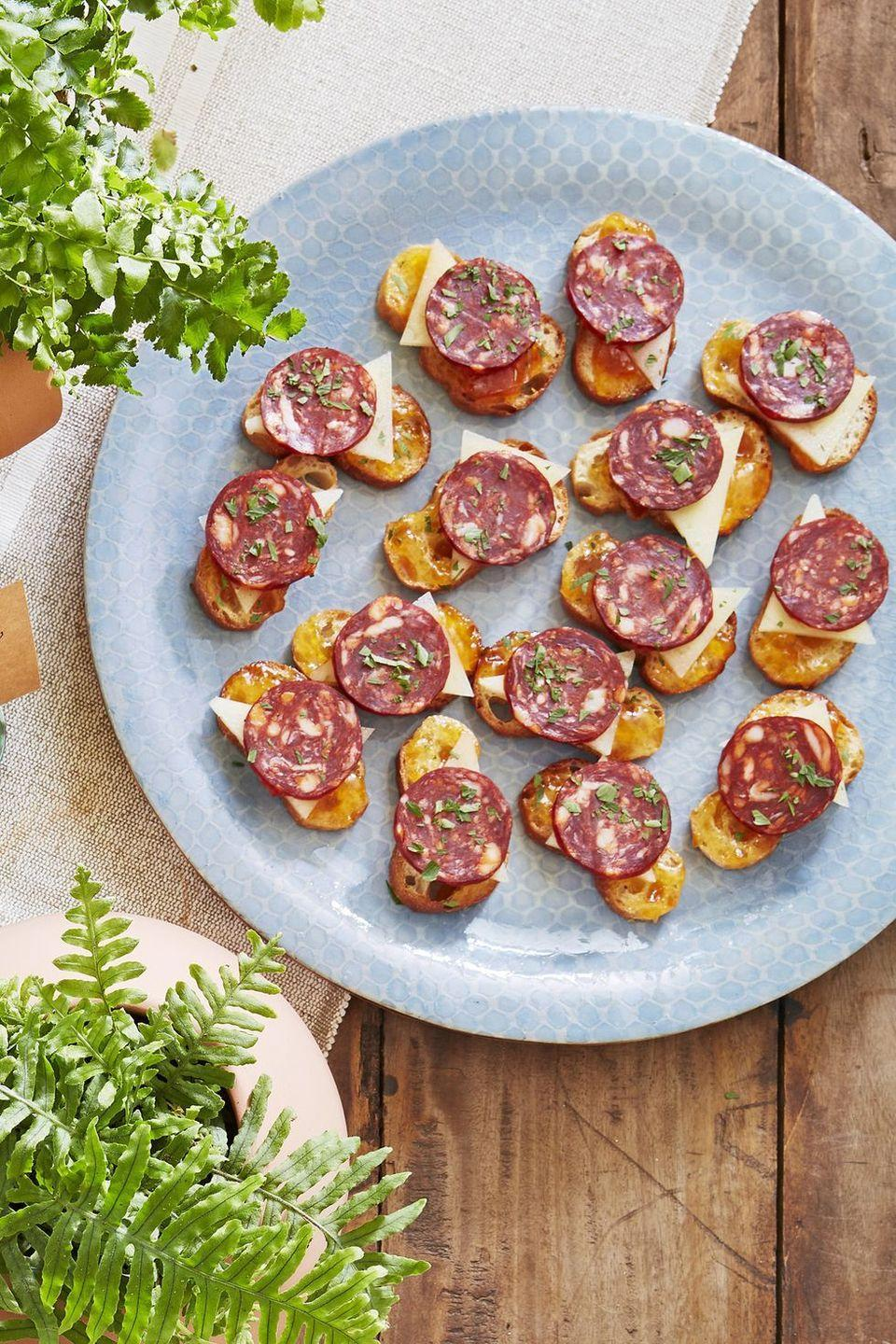 """<p>Apricot jam gives this meat and cheese combo a pleasing hint of sweetness. </p><p><strong><a href=""""https://www.countryliving.com/food-drinks/a22739023/chorizo-and-manchego-crostini-recipe/"""" rel=""""nofollow noopener"""" target=""""_blank"""" data-ylk=""""slk:Get the recipe"""" class=""""link rapid-noclick-resp"""">Get the recipe</a>.</strong> </p>"""