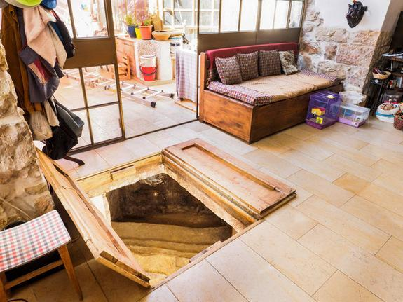 """Stairs to an ancient ritual bath, or """"miqwe,"""" start in a homeowner's living room in Ein Karem."""