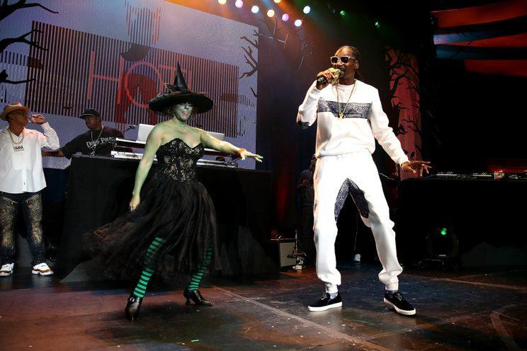Snoop Dogg and the Wicked Witch bust a move. (Photo: Randy Shropshire/Getty Images)