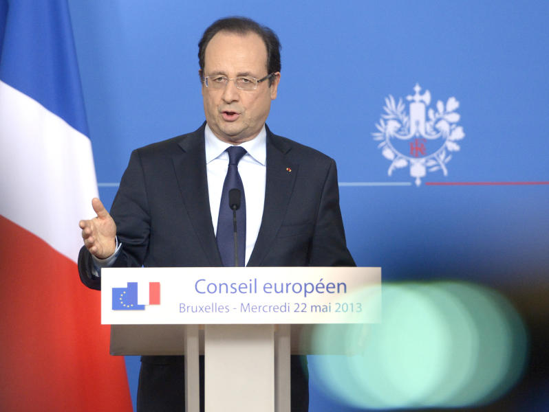 French President Francois Hollande addresses the media at the end of an EU summit in Brussels on Wednesday, May 22, 2013. European Union leaders on Wednesday sought to advance their fight against tax fraud and close the loopholes for large corporations' tax avoidance schemes. (AP Photo/Ezequiel Scagnetti)