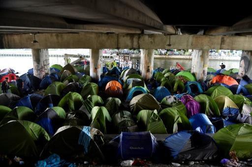 Security forces cleared the biggest migrant camp in the French capital where 1,700 people lived in makeshift tents alongside a canal