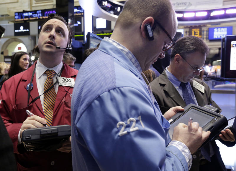 Traders work on the floor of the New York Stock Exchange Wednesday, March 13, 2013. Stocks were little changed in early trading on Wall Street after a report showed that retail sales rose more than forecast in February. (AP Photo/Richard Drew)