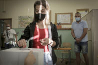 A woman casts her vote in Sofia, Sunday, July 11, 2021. Bulgarians are voting in a snap poll on Sunday after a previous election in April produced a fragmented parliament that failed to form a viable coalition government. (AP Photo/Valentina Petrova)