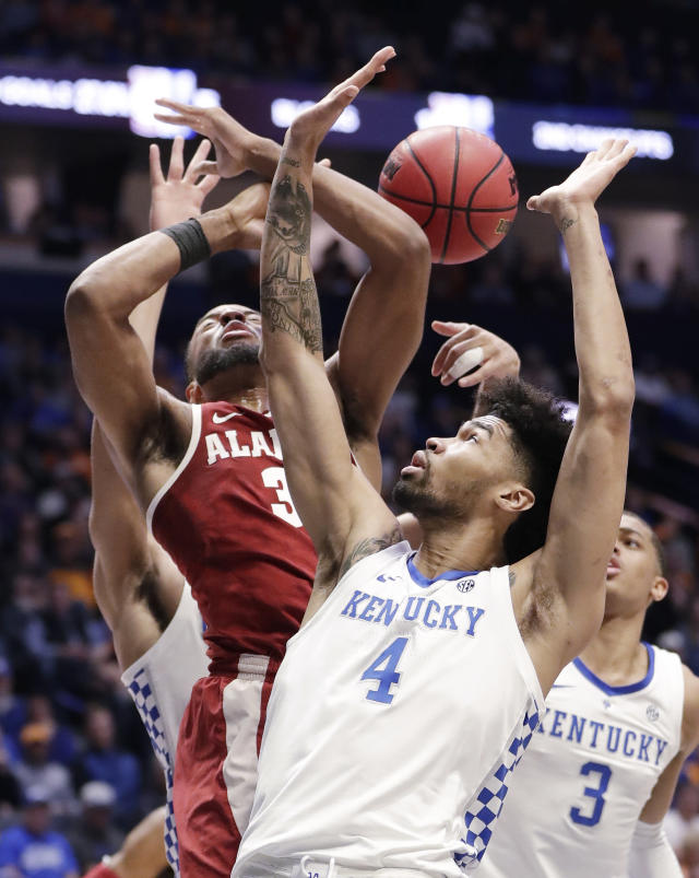 Kentucky forward Nick Richards (4) and Alabama forward Galin Smith (30) fight for a rebound in the first half of an NCAA college basketball game at the Southeastern Conference tournament Friday, March 15, 2019, in Nashville, Tenn. (AP Photo/Mark Humphrey)
