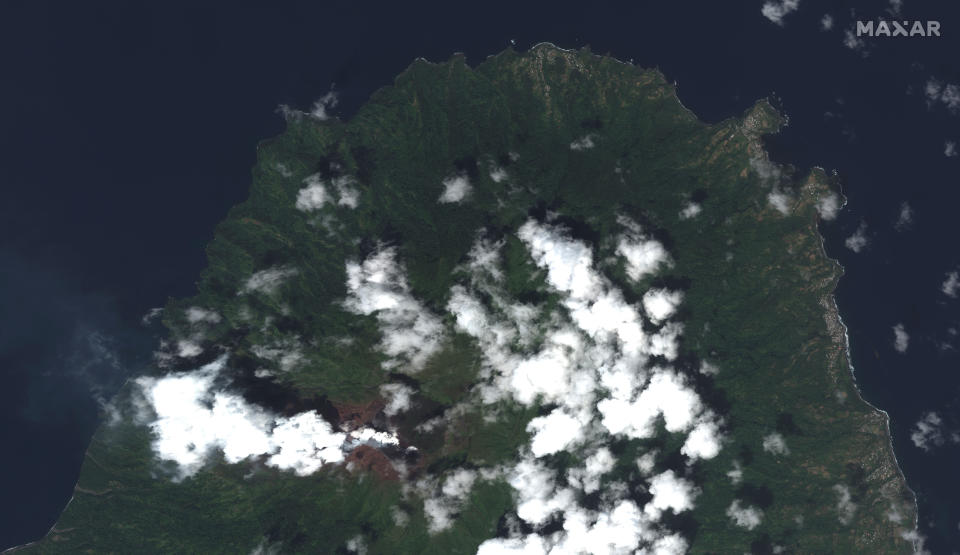 This image provided by Maxar Technologies shows La Soufriere volcano on the Caribbean island of St Vincent, Thursday, April 8, 2021, the day before it erupted.