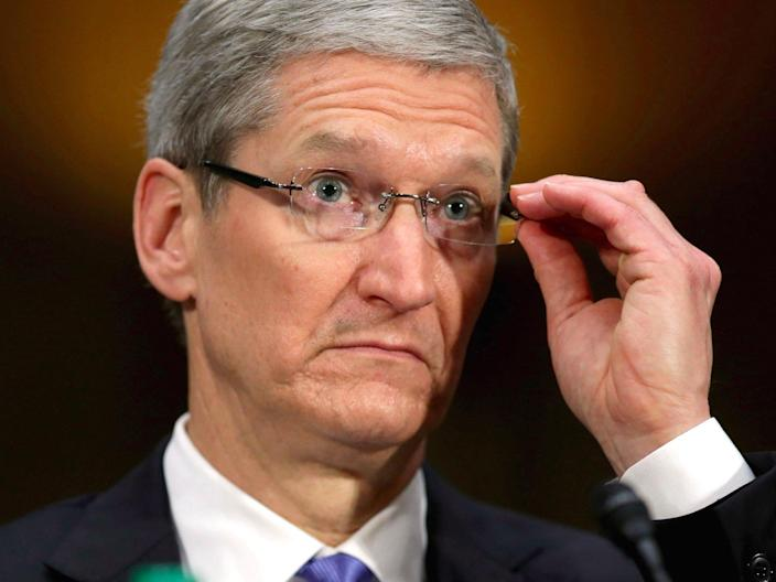 tim cook apple ceo perplexed unhappy glasses