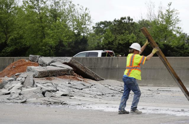 Construction crews work on a section of Interstate 20 West that buckled in Decatur, Ga., Monday, April 17, 2017. (AP Photo/David Goldman)