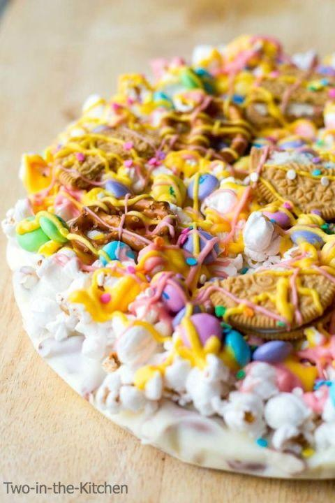 """<p>Merge two of your favorite things (sweets and pizza) and you've got the ultimate DIY candy recipe for Easter. While there's no cheese or tomato sauce here, it's layered like a pizza pie and can be eaten by the slice. </p><p><strong>Get the recipe at <a href=""""http://www.prettymyparty.com/easter-candy-pizza/"""" rel=""""nofollow noopener"""" target=""""_blank"""" data-ylk=""""slk:Pretty by Party"""" class=""""link rapid-noclick-resp"""">Pretty by Party</a>.</strong></p>"""