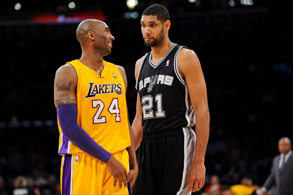 <p>2012: Tim Duncan #21 of the San Antonio Spurs and Kobe Bryant #24 of the Los Angeles Lakers share a laugh while playing on November 13, 2012 at the Staples Center in Los Angeles, California. </p>
