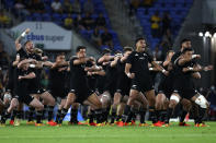 New Zealand players perform a haha, a traditional Maori challenge, before their Rugby Championship test match against South Africa on the Gold Coast, Australia, Saturday, Oct. 2, 2021. (AP Photo/Tertius Pickard)