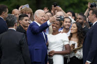 President Joe Biden poses for a photo with attendees during an Independence Day celebration on the South Lawn of the White House, Sunday, July 4, 2021, in Washington. (AP Photo/Patrick Semansky)