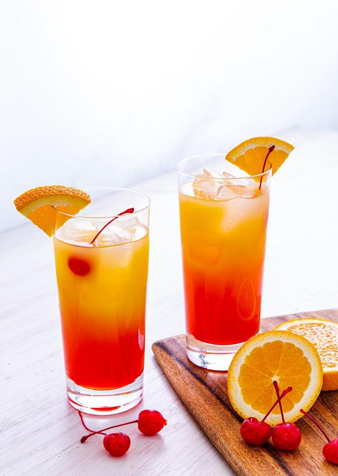 """<p>Beautiful to look at...and to drink! </p><p>Get the recipe from <a href=""""https://www.delish.com/cooking/recipe-ideas/a31293446/tequila-sunrise-recipe/"""" target=""""_blank"""">Delish.</a></p>"""