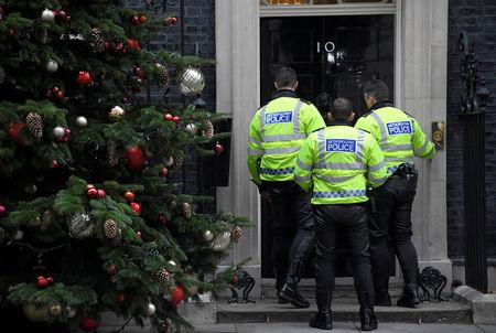 Motorcycle police officers wait to enter 10 Downing Street, London, Britain, December 6, 2017. REUTERS/Toby Melville