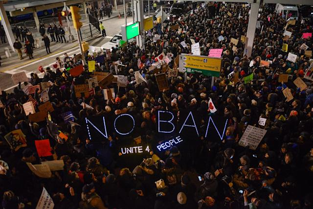 <p>JAN. 28, 2017 – Protestors rally during a demonstration against the Muslim immigration ban at John F. Kennedy International Airport in New York City. President Trump signed the controversial executive order that halted refugees and residents from predominantly Muslim countries from entering the United States. (Photo: Stephanie Keith/Getty Images) </p>