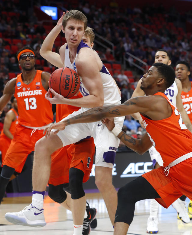 TCU forward Vladimir Brodziansky (10) pulls down a rebound from Syracuse guard Frank Howard (23) during the first half of an NCAA men's college basketball tournament first-round game in Detroit, Friday, March 16, 2018. (AP Photo/Paul Sancya)