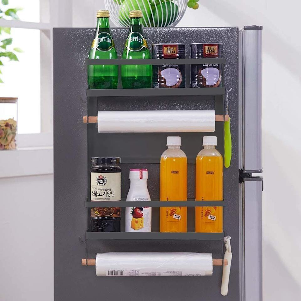 """No counter space? No problem. <a href=""""https://amzn.to/2HJke0n"""" target=""""_blank"""" rel=""""noopener noreferrer"""">This magnetic paper towel holder and rack</a> will organize spices, oils, jars, bottles, cleaners and pretty much anything else you want within reach. Use one of the paper towels holders as a towel rack, and you're set. It even includes a tiny hook on the side that's perfect for hanging potholders and oven mitts.<a href=""""https://amzn.to/2HJke0n"""" target=""""_blank"""" rel=""""noopener noreferrer"""">Get it for $30 on Amazon</a>."""