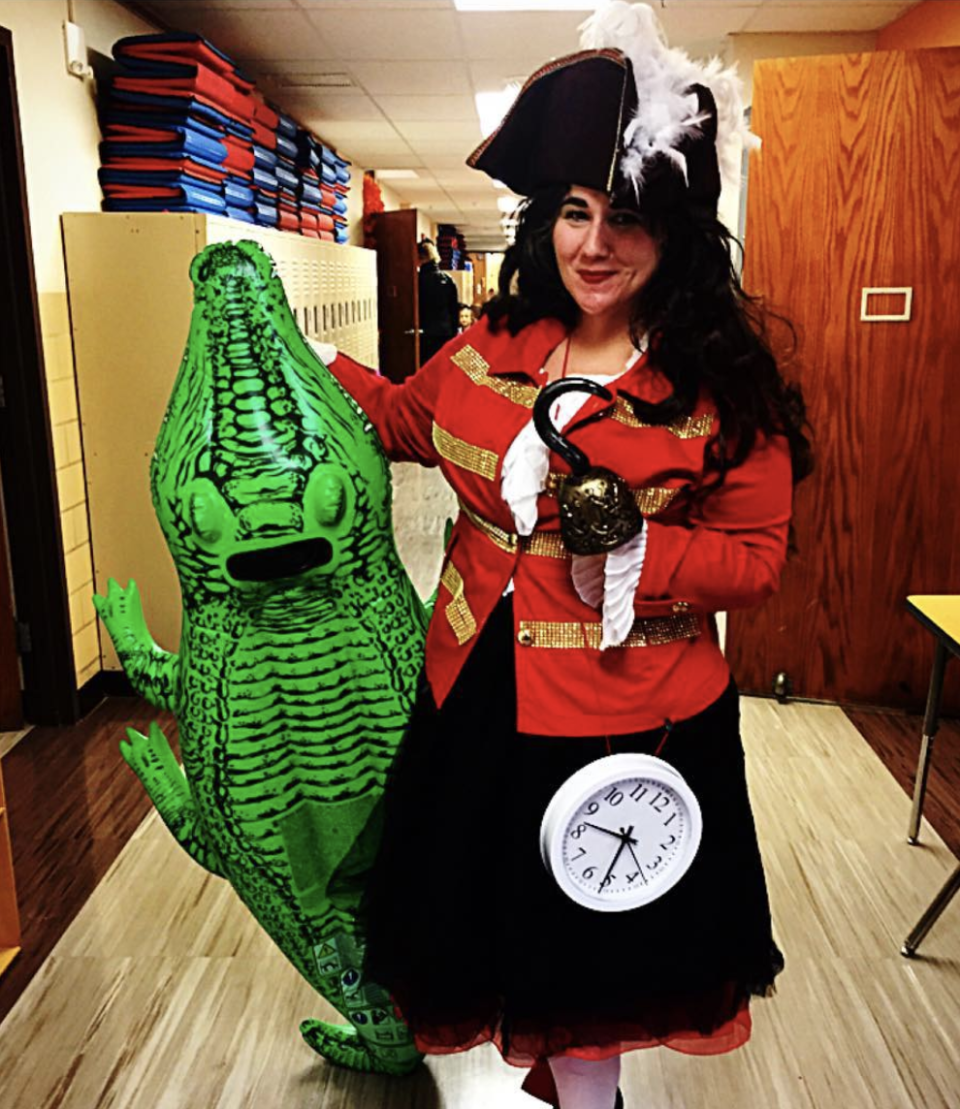 """<p>Though this looks elaborate, you don't need much to channel the infamous pirate from <em>Peter Pan. </em>Simply glue gold ribbon onto a red blazer, strap on a clock, throw on a feathered cap, and—for bonus points—tote around an inflatable crocodile. </p><p><a class=""""link rapid-noclick-resp"""" href=""""https://www.amazon.com/Intex-Giant-Gator-Ride-RECREATION/dp/B013COCKNK/ref=pd_sbs_21_t_1/136-1473108-4298935?_encoding=UTF8&pd_rd_i=B013COCKNK&pd_rd_r=51880c26-d96f-4b20-81cd-4dd1c9ee7c6c&pd_rd_w=VGzNQ&pd_rd_wg=xb9lR&pf_rd_p=5cfcfe89-300f-47d2-b1ad-a4e27203a02a&pf_rd_r=0T93A01MVBNTMAJKFYQB&psc=1&refRID=0T93A01MVBNTMAJKFYQB&tag=syn-yahoo-20&ascsubtag=%5Bartid%7C10072.g.28615520%5Bsrc%7Cyahoo-us"""" rel=""""nofollow noopener"""" target=""""_blank"""" data-ylk=""""slk:SHOP FLOAT"""">SHOP FLOAT</a></p>"""