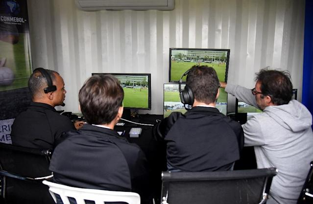 Despite considerable teething problems -- confusion about why decisions are made and lengthy delays -- Germany's top 18 clubs unanimously voted to keep the VAR for next season with only one abstention (AFP Photo/Norberto DUARTE)