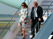 Melania Trump touched down in Japan for a four-day state visit in a Calvin Klein shirt dress emblazoned with old postcards. She finished the flight-ready ensemble with a pair of Christian Louboutin heels. [Photo: Getty]
