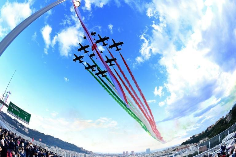A wide angle view shows the Italian Air Force acrobatic unit Frecce Tricolori performing over the new San Giorgio bridge on its inauguration day