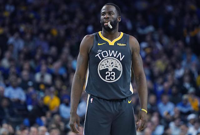 "<a class=""link rapid-noclick-resp"" href=""/nba/players/5069/"" data-ylk=""slk:Draymond Green"">Draymond Green</a> injured his left ankle after he stepped on <a class=""link rapid-noclick-resp"" href=""/nba/players/4720/"" data-ylk=""slk:DeMarcus Cousins"">DeMarcus Cousins</a>' foot on Saturday night against the <a class=""link rapid-noclick-resp"" href=""/nba/teams/houston/"" data-ylk=""slk:Rockets"">Rockets</a>. (Thearon W. Henderson/Getty Images)"