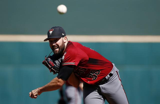 "Is <a class=""link rapid-noclick-resp"" href=""/mlb/players/9691/"" data-ylk=""slk:Robbie Ray"">Robbie Ray</a> firmly in the circle of trust for good? (AP Photo/Ross D. Franklin)"