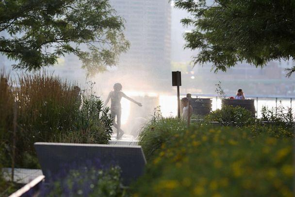 PHOTO: A girl cools off in a fountain at Gantry Plaza State Park in Long Island City, New York, July 4, 2020. (Caitlin Ochs/Reuters)