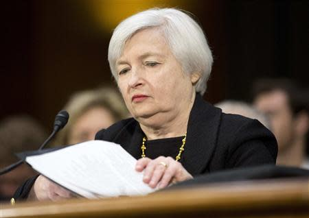 Janet Yellen, President Barack Obama's nominee to lead the U.S. Federal Reserve, prepares to testify at her U.S. Senate Banking Committee confirmation hearing in Washington November 14, 2013. REUTERS/Joshua Roberts