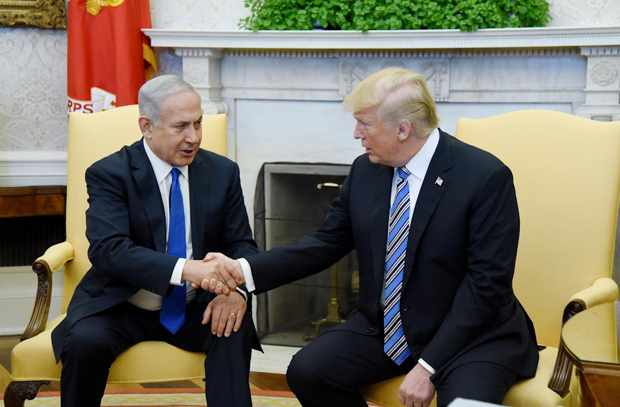 President Trump (R) shakes hands with Israel Prime Minister Benjamin Netanyahu as they meet in the Oval Office of the White House March 5, 2018 in Washington, D.C.