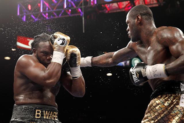 Deontay Wilder (R) punches Bermane Stiverne during their Jan. 17, 2015, fight for the WBC heavyweight title in Las Vegas. They will fight again on Saturday at the Barclays Center in Brooklyn and the bout will be televised by Showtime. (Getty Images)