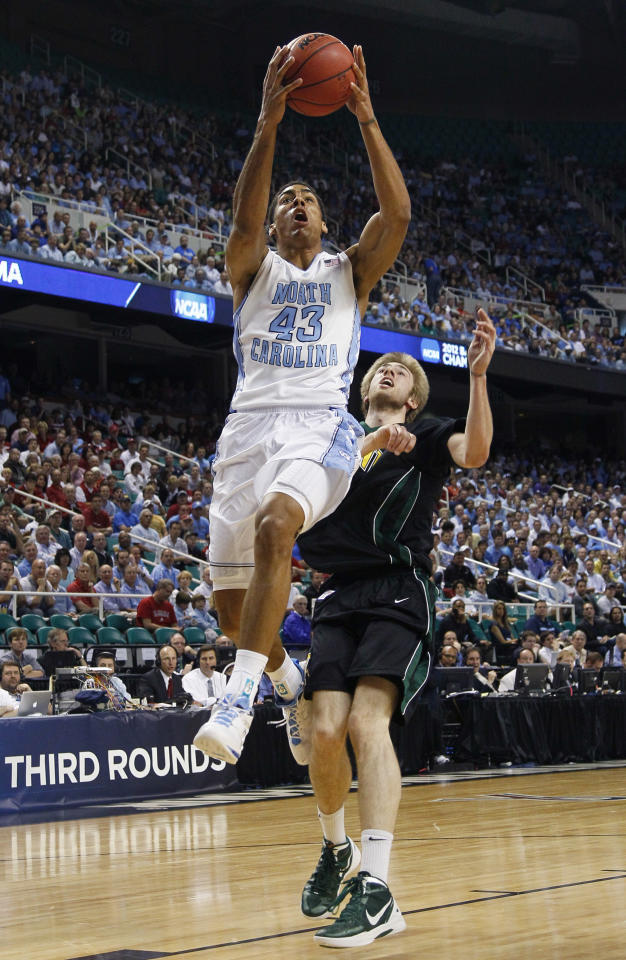 North Carolina's James Michael McAdoo (43) drives past Vermont's Matt Glass (34) during the first half of a Midwest Regional NCAA tournament second-round college basketball game in Greensboro, N.C., Friday, March 16, 2012. (AP Photo/Gerry Broome)