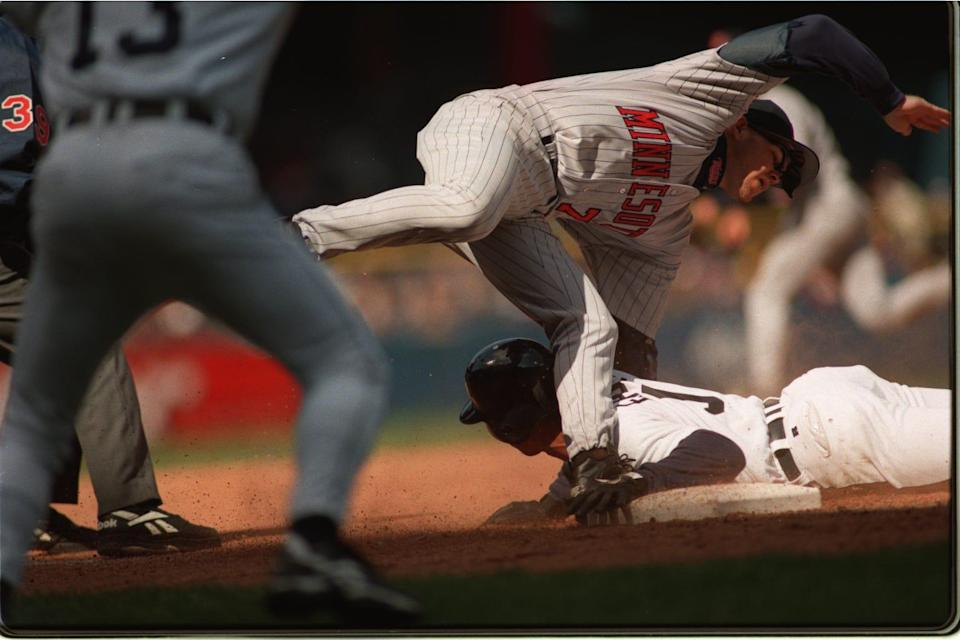 Third baseman Chris Hocking of the Minnesota Twins  commits an error while attempting to tag  Damion Easley in the eighth inning on April 7, 1997.  Easley stole second and was attempting to steal third when this error occurred.