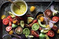 """If you can find a rainbow of different tomatoes for this salad, all the better. The simple feta dressing keeps well for up to two weeks in a jar in the refrigerator. Dress the salad just before serving. <a href=""""https://www.epicurious.com/recipes/food/views/heirloom-tomato-salad-with-feta-dressing?mbid=synd_yahoo_rss"""" rel=""""nofollow noopener"""" target=""""_blank"""" data-ylk=""""slk:See recipe."""" class=""""link rapid-noclick-resp"""">See recipe.</a>"""