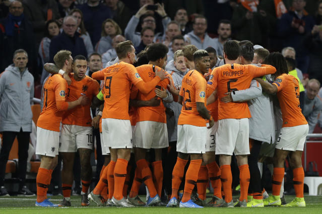 Netherlands players celebrate scoring their side's first goal during the Euro 2020 group C qualifying soccer match between The Netherlands and Estonia at the Johan Cruyff ArenA in Amsterdam, Netherlands, Tuesday, Nov. 19, 2019. (AP Photo/Peter Dejong)