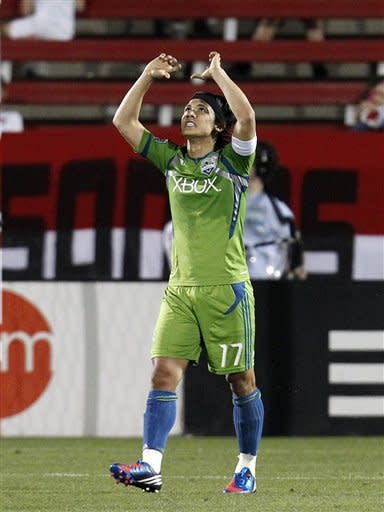 Seattle Sounders' Fredy Montero celebrates his first of two goals in the second half of an MLS soccer game against FC Dallas on Wednesday, May 9, 2012, in Frisco, Texas. Montero scored twice in a 3-minute span to lead the Sounders to their fifth consecutive victory, 2-0. (AP Photo/Tony Gutierrez)