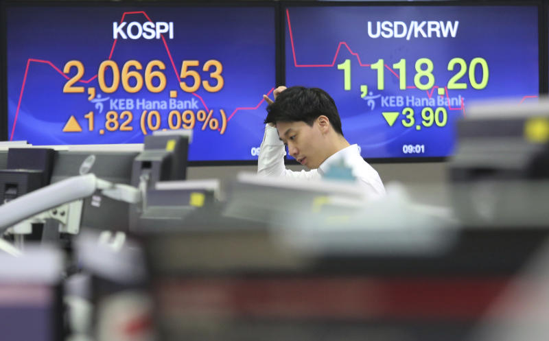 A currency trader watches monitors at the foreign exchange dealing room of the KEB Hana Bank headquarters in Seoul, South Korea, Thursday, Jan. 10, 2019. Asian markets were mostly lower Thursday as U.S. and Chinese officials wrapped up three days of talks in Beijing without significant breakthroughs.(AP Photo/Ahn Young-joon)