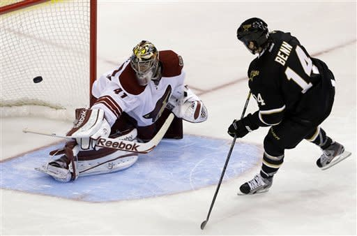 Dallas Stars' Jamie Benn (14) scores a shootout goal against Phoenix Coyotes goalie Mike Smith (41) during an NHL hockey game on Friday, Feb. 1, 2013, in Dallas. The goal helped the Stars to a 4-3 win. (AP Photo/Tony Gutierrez)