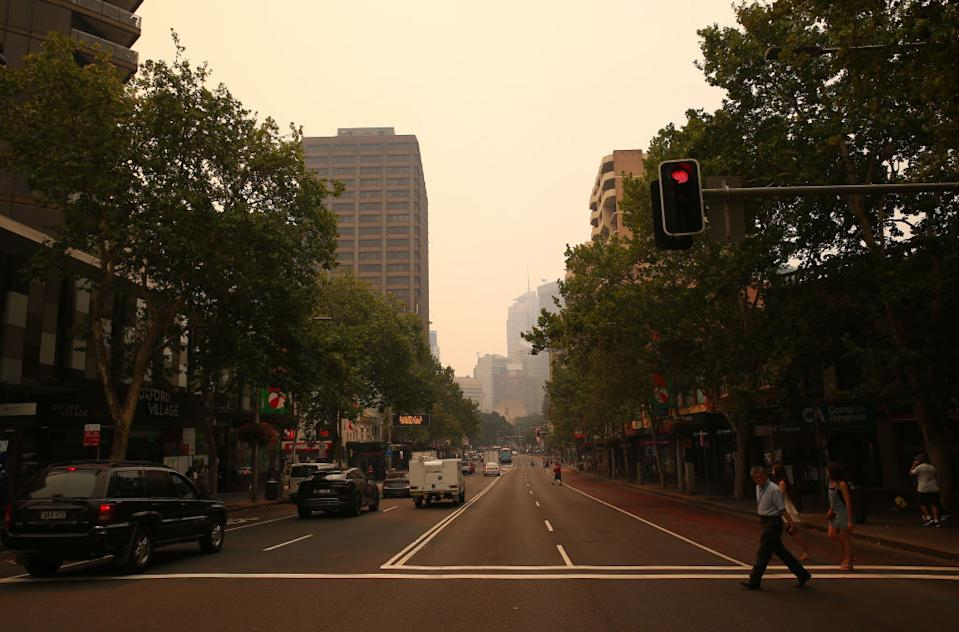Face masks are flying off shelves in Sydney as smoke blankets parts of the state. Source: Getty