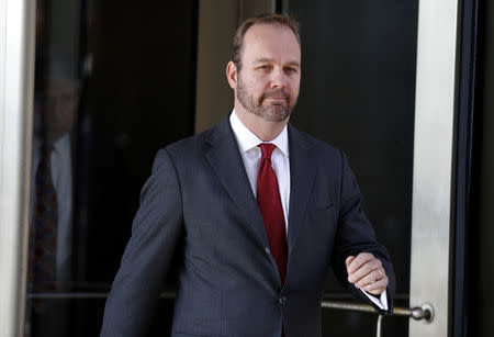 Rick Gates, former campaign aide to U.S. President Donald Trump, departs after a bond hearing at U.S. District Court in Washington, U.S., December 11, 2017. REUTERS/Joshua Roberts