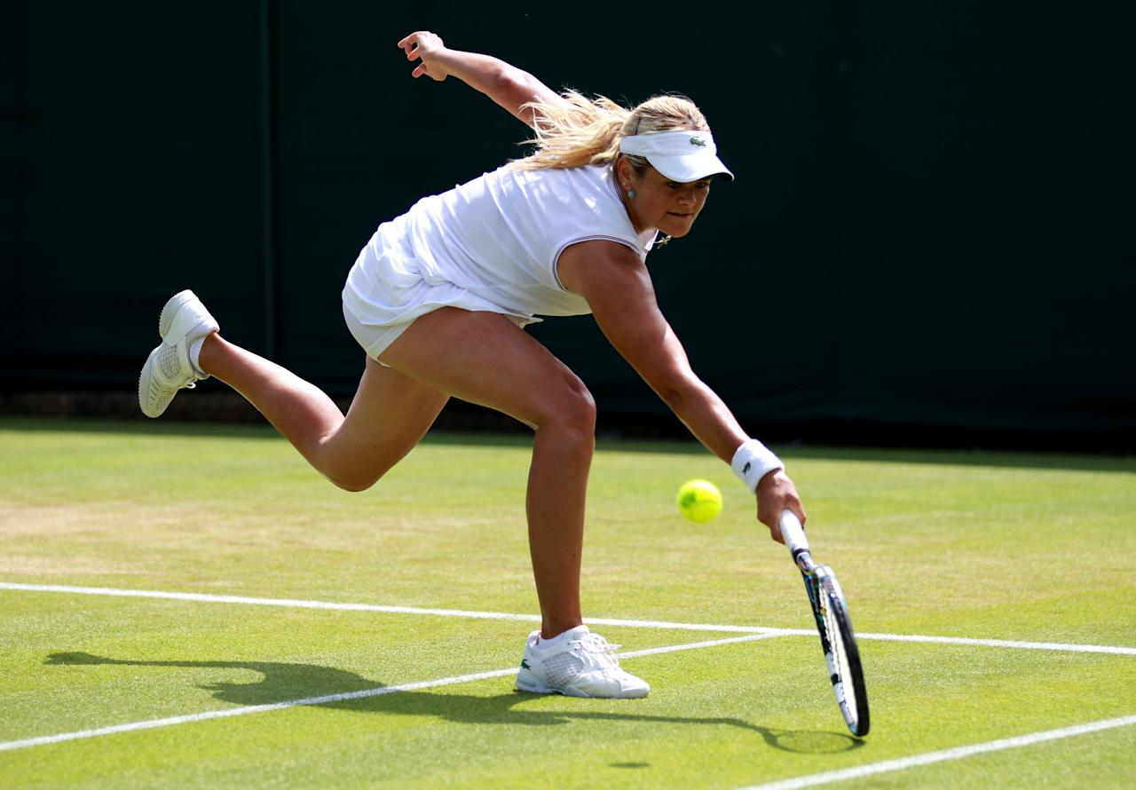 LONDON, ENGLAND - JUNE 28:  Aleksandra Wozniak of Canada hits a backhand return during her Ladies' Singles second round match against Jie Zheng of China  on day four of the Wimbledon Lawn Tennis Championships at the All England Lawn Tennis and Croquet Club on June 28, 2012 in London, England.  (Photo by Clive Brunskill/Getty Images)