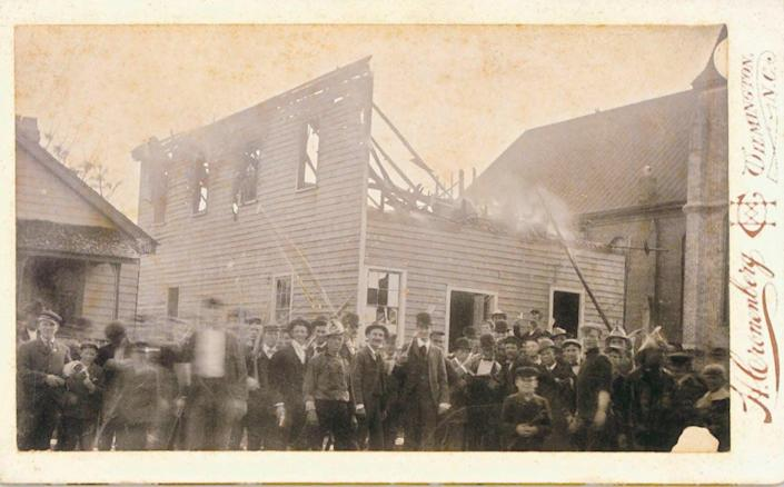 """<span class=""""caption"""">Armed white insurrectionists murdered Black men and burned Black businesses, including this newspaper office, during the Wilmington coup of 1898.</span> <span class=""""attribution""""><a class=""""link rapid-noclick-resp"""" href=""""http://www.history.ncdcr.gov/1898-wrrc/hearings.htm"""" rel=""""nofollow noopener"""" target=""""_blank"""" data-ylk=""""slk:Daily Record, North Carolina Archives and History"""">Daily Record, North Carolina Archives and History</a></span>"""