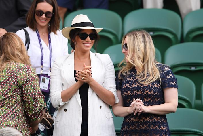 Meghan Markle, Duchess of Sussex watches on during the ladies' Singles Second round match between Serena Williams of The United States and Kaja Juvan of Slovenia during Day four of The Championships - Wimbledon 2019 at All England Lawn Tennis and Croquet Club on July 04, 2019 in London, England. (Photo by Laurence Griffiths/Getty Images) | Laurence Griffiths&Getty Images