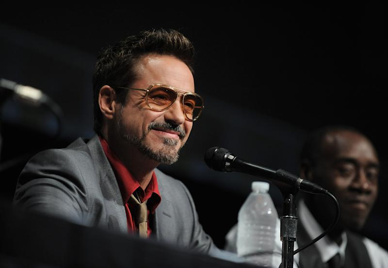 "Robert Downey Jr. speaks at the ""Iron Man 3"" panel 2012 Comic Con on Saturday, July 14, 2012 in San Diego, Calif. (Photo by Jordan Strauss/Invision/AP)"