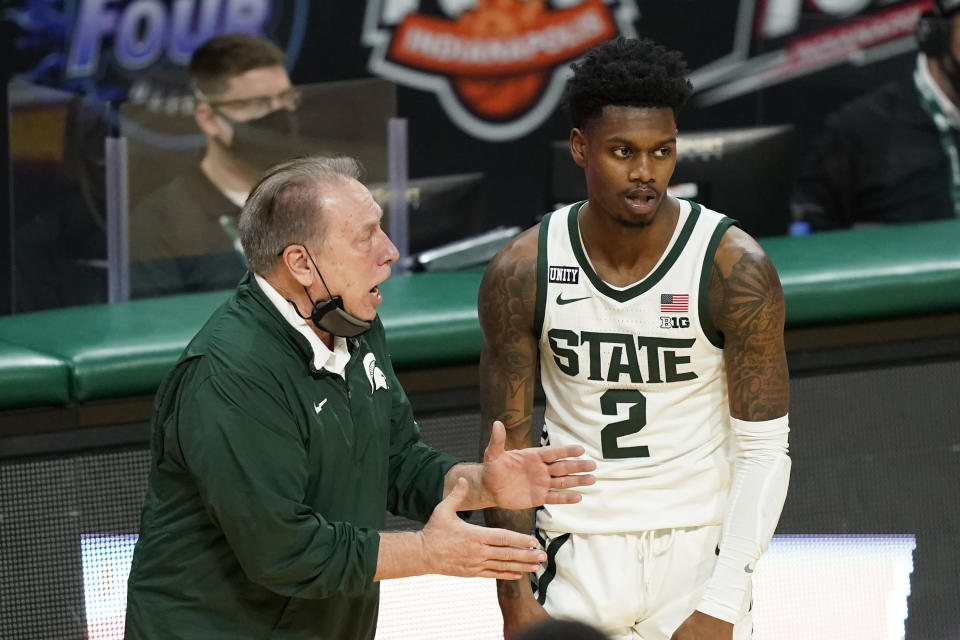 Michigan State head coach Tom Izzo talks with guard Rocket Watts (2) during the second half of an NCAA college basketball game against Illinois, Tuesday, Feb. 23, 2021, in East Lansing, Mich. (AP Photo/Carlos Osorio)
