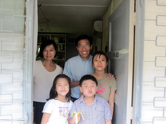 The Chee family stand at the doorway of their home. (Yahoo! photo/Jeanette Tan)